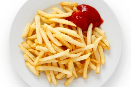 Crispy French fries with ketchup ready to eat photo