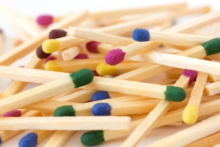 Pile of mixed colored match sticks photo