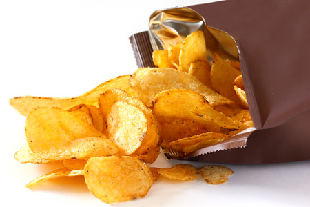 crisps: Open packet of crisps on white Stock Photo
