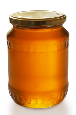 Closed jar of honey  photo