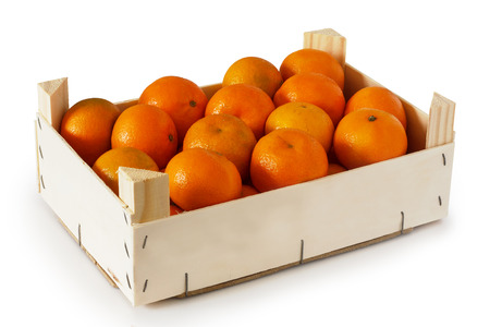 Wooden box filled with tangerines Stockfoto