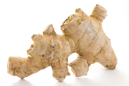 fresh ginger: Fresh ginger root on white surface