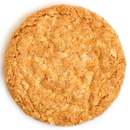 biscuit: Single whole golden oat biscuit. Shot from above. Stock Photo