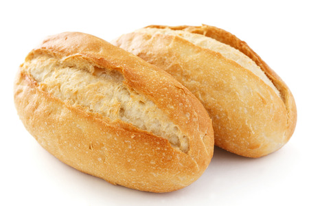 Two crusty mini baguettes on white surface Imagens