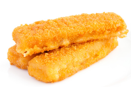 Fried fishfingers on white surface. photo