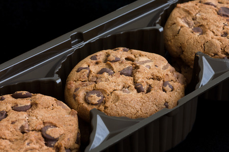 biscuit factory: Commercial chocolate chip cookies in plastic tray