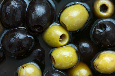 Mixed black and green olives in brine. photo
