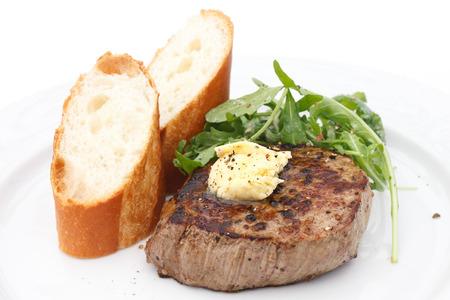 Perfect roast pork tenderloin fillet steak topped with melting butter. photo