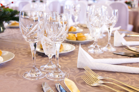 banquet table: Luxury banquet table setting with crystal glasses.
