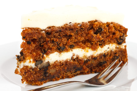 frosting': Slice of carrot cake with rich frosting. On plate. Stock Photo