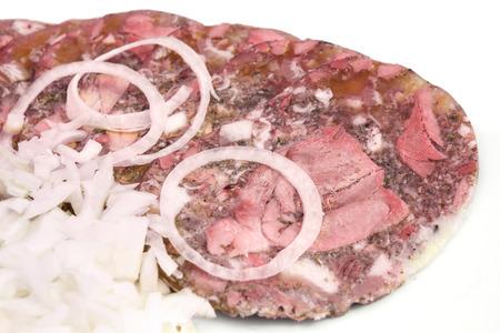 brawn: Pork brawn slices  with onion on plate.