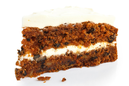 frosting': Slice of carrot cake with rich frosting. Isolated.