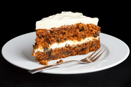 Slice of carrot cake with rich frosting. On plate. Stock Photo