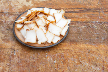 lard: Pieces of smoked lard on ceramic plate. Place for text. Stock Photo
