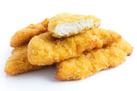 Golden fried chicken strips on white. Archivio Fotografico
