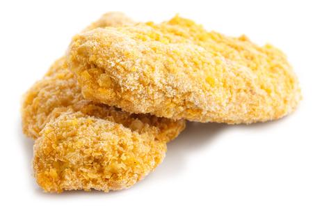 Two frozen bread crumbed chicken strips on white.