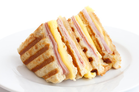 cheese plate: Toasted ham and cheese panini sandwich.