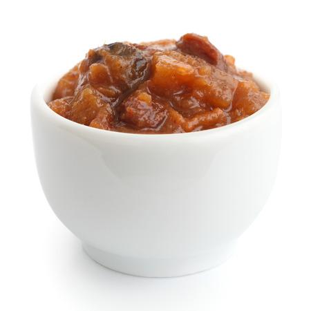 chutney: Rough fruit chutney in small white dish. Stock Photo