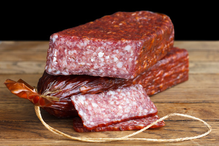 grease paint: Premium salami, cut with slices on wood. Stock Photo