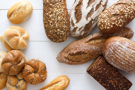 bakery bread: Many mixed breads and rolls shot from above.