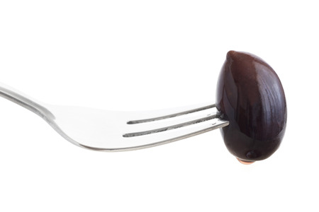 kalamata: Single Greek kalamata olive on fork. Isolated on white.