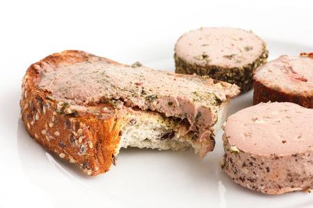 bite: Rustic bread spread with pate  bite missing. Stock Photo