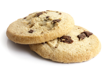 shortbread: Isolated round chocolate chip shortbread biscuits. Broken piece. Stock Photo