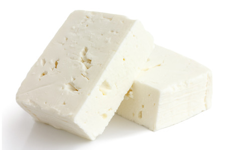 Greek feta cheese block isolated on white.