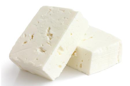 Griekse feta kaas blok geïsoleerd op wit. Stockfoto