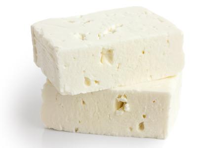 ギリシャのフェタ チーズ ブロックは、白で隔離。 写真素材
