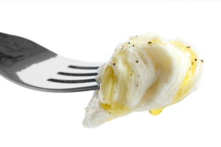 mouthful: Mouthful of torn mozzarella on fork with oil and pepper. Isolated Stock Photo