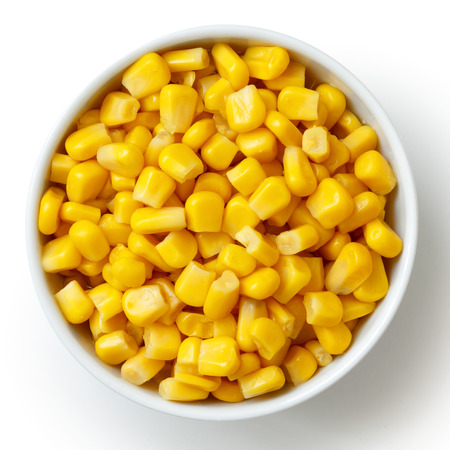 tinned: Bowl of tinned sweetcorn isolated from above on white. Stock Photo