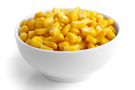 tinned: Bowl of tinned sweetcorn isolated on white. Stock Photo
