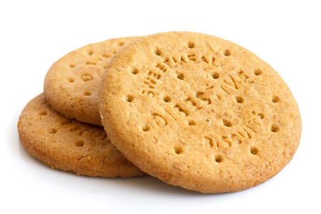 Stack of sweetmeal digestive biscuits isolated on white. Standard-Bild