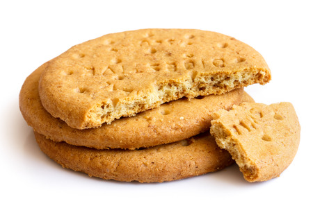biscuit: Stack of sweetmeal digestive biscuits isolated on white. Stock Photo