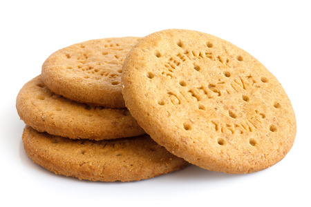 Stack of sweetmeal digestive biscuits isolated on white. Foto de archivo