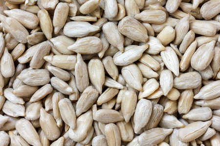 shelled: Shelled sunflower seeds. Background from above. Stock Photo