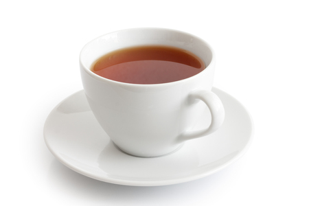 White ceramic cup and saucer with rooibos tea. Isolated.