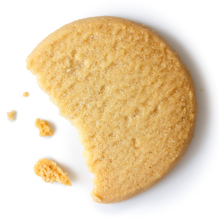 Single round shortbread biscuit with crumbs and bite missing. From above. Stockfoto