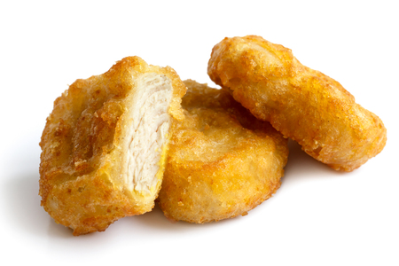 chicken: Three golden deep-fried battered chicken nuggets isolated on white in perspective. One cut with meat showing.