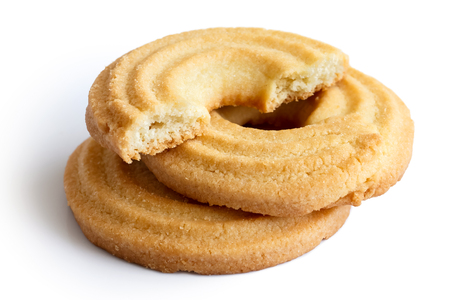 biscuits: Three butter ring biscuits isolated on white in perspective. One broken in half with crumb showing. Stock Photo