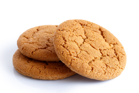 galletas: Tres galletas de jengibre aislados en blanco. Foto de archivo