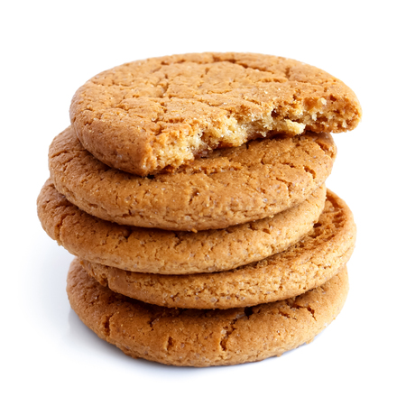 Stack of ginger biscuits with half biscuit on top. Isolated on white.