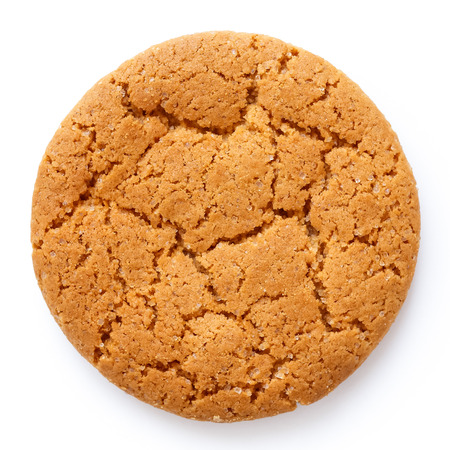 Single round ginger biscuit isolated on white from above. Archivio Fotografico