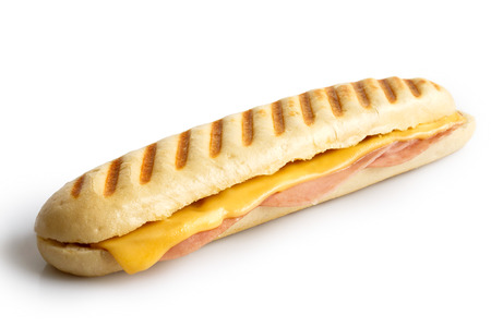 Whole cheese and ham toasted panini melt. Isolated on white.