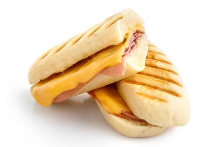 jamon y queso: Corte el queso y jamón tostado panini se funden con marcas de la parrilla. Aislado en blanco. Foto de archivo