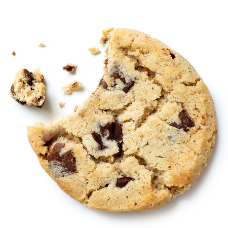 missing bite: Light chocolate chip cookie, bite missing with crumbs from above.