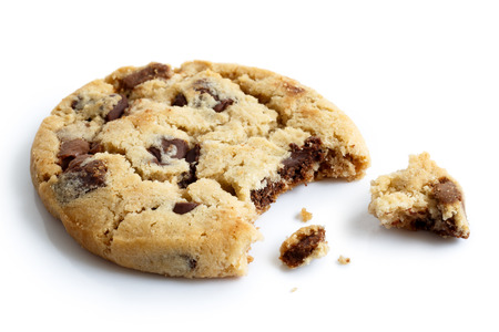 crumbs: One light chocolate chip cookie, bite missing with crumbs, isolated.