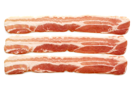 uncooked bacon: Three strips of streaky uncooked bacon isolated on white from above.