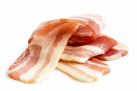 uncooked bacon: Pile of streaky uncooked bacon isolated on white.